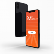 Demo models of a mobile phone showcasing the new app in bright orange.